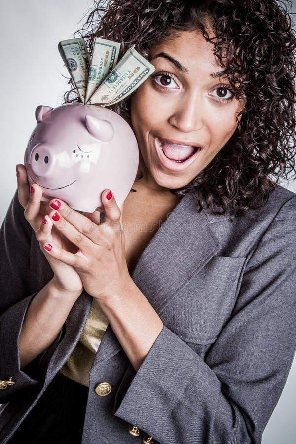 Czarna prosiątko banka kobieta obraz stock