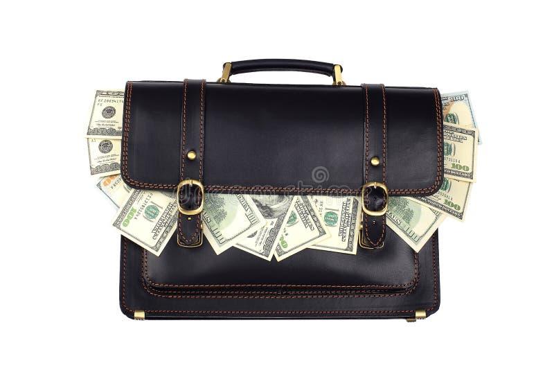 Czarna rzemienna teczka z dolarami odizolowywającymi na białym backgroun zdjęcia stock