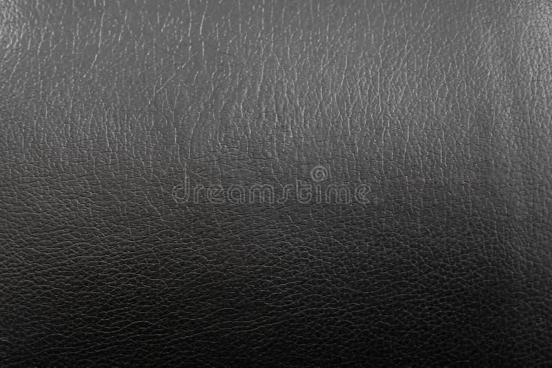 Czarna sztucznej skóry tekstura z gradientem i przemiana od zmroku światło obrazy royalty free