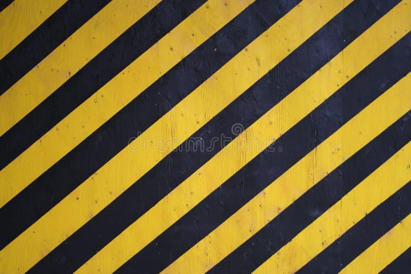 czarna tła ostrzegawczy paskuje żółty fotografia royalty free