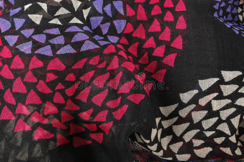 Czarna tkanina z menchiami i błękitem obraz stock
