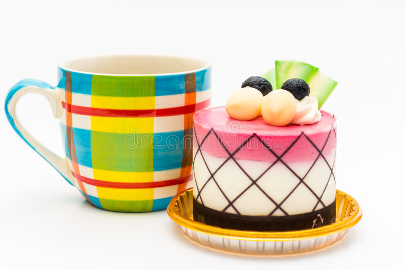 czarnej jagody babeczka z czarną kawą w koloru kawowym kubku obrazy royalty free