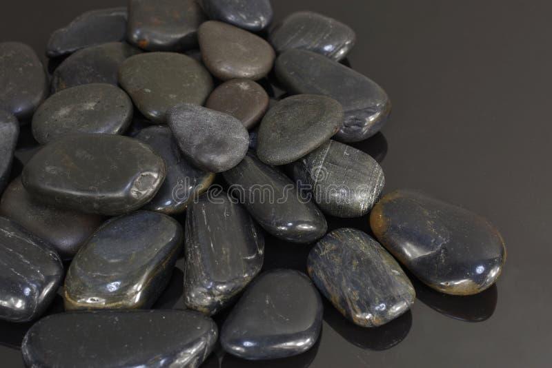 Czarni bazaltów kamienie fotografia royalty free