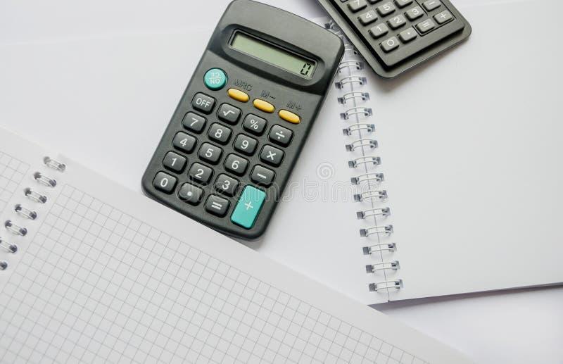 Czarni kalkulatorzy odizolowywający na białym tle obrazy stock