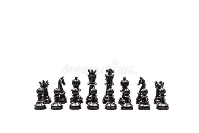 Czarni szachowi pionkowie w pozycjach, na białym tle fotografia royalty free