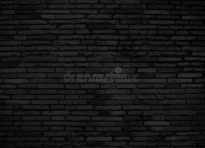 Czarny ściana z cegieł dla tła fotografia stock