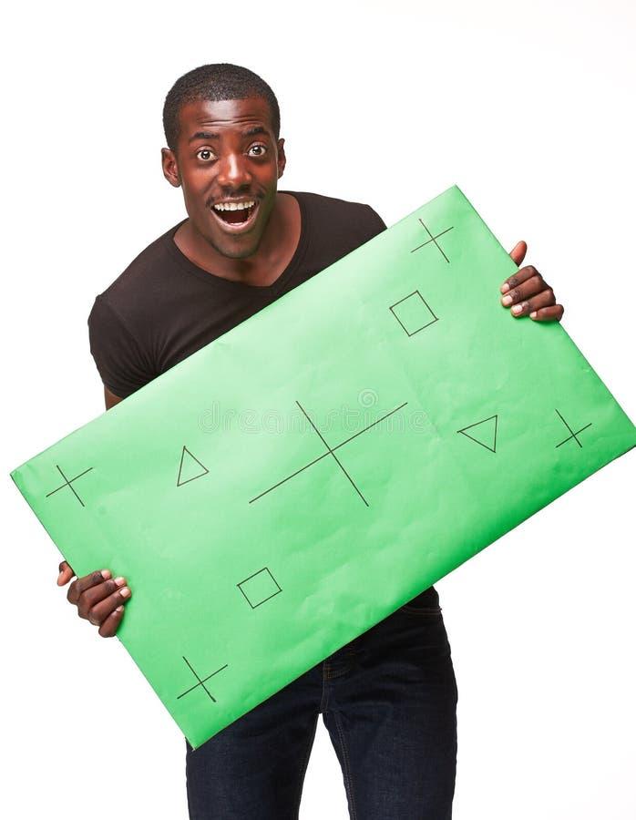 Download Czarny biznesmen z panelem zdjęcie stock. Obraz złożonej z sztandar - 53791932
