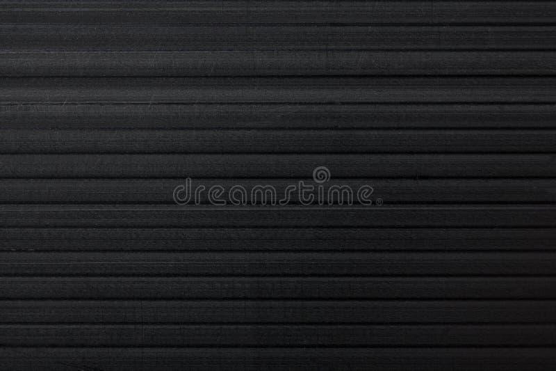 Czarny flet deski tekstury tło Materialny i przemysłowy pojęcie Zbliżenia corriboard klingeryt zdjęcia stock