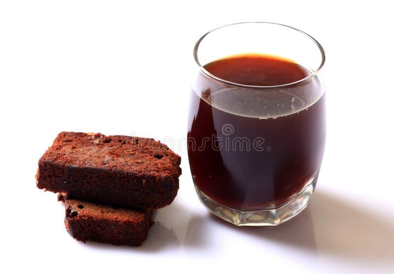 Czarny herbata i tort zdjęcia royalty free