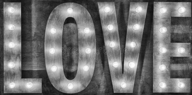 Czarny i biały szyldowe miłość żarówki na drewnianym tle obrazy royalty free