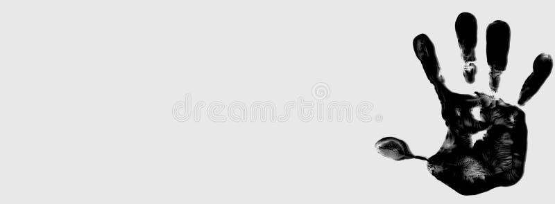 Czarny koloru handprint na białym tle, przedstawia pomysł zatrzymywać przemoc przeciw kobietom fotografia royalty free