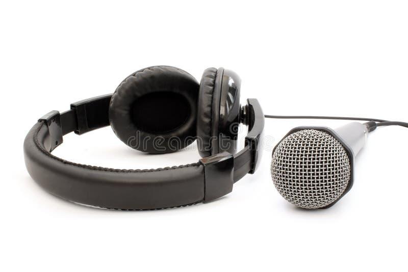 Czarny mikrofon i słuchawki zdjęcie royalty free