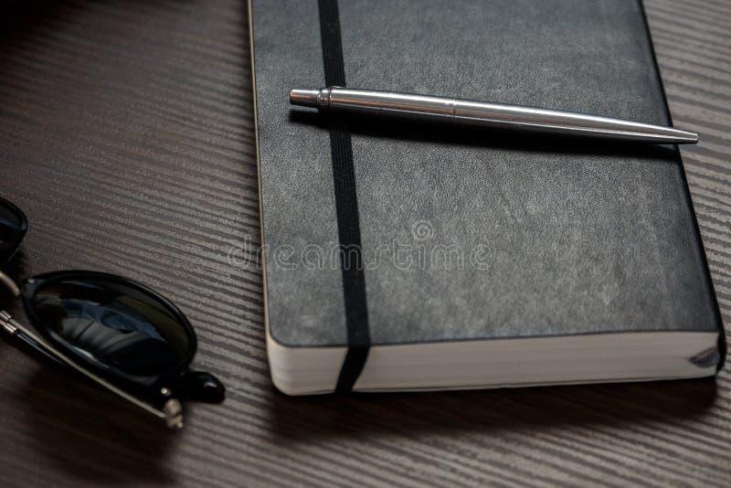 czarny notes fotografia stock