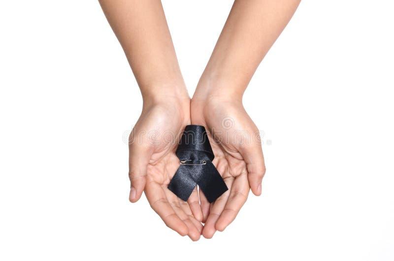 Czarny opłakuje faborek w ręce zdjęcia royalty free