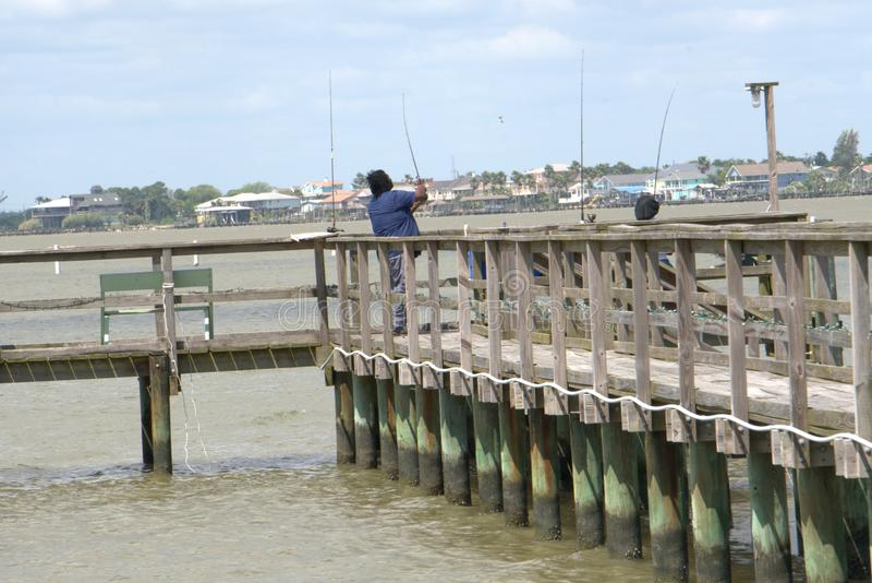 Czarny pary mola połowu zatoki wybrzeże fotografia stock