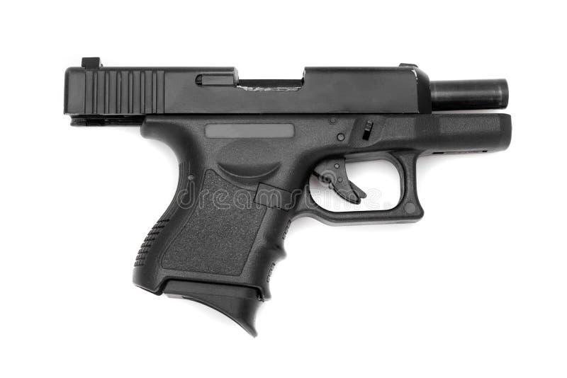 Czarny pistolet odizolowywający na białym tle obraz stock