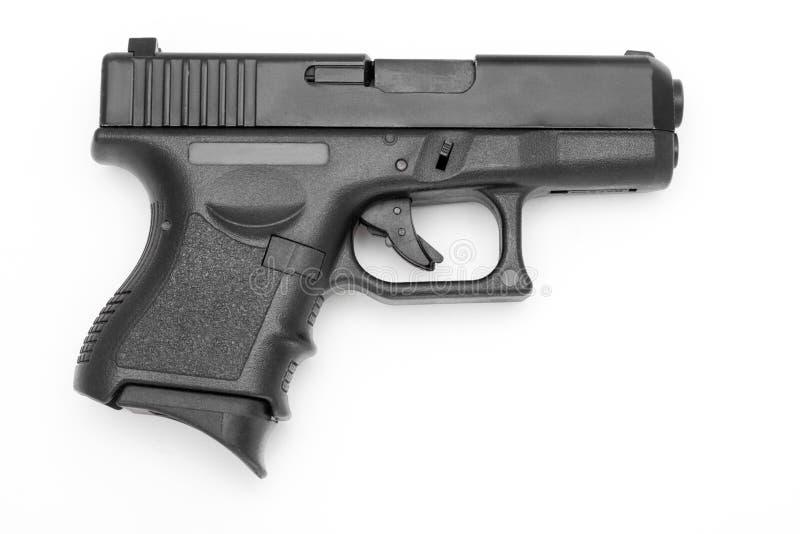 Czarny pistolet odizolowywający na białym tle zdjęcia stock