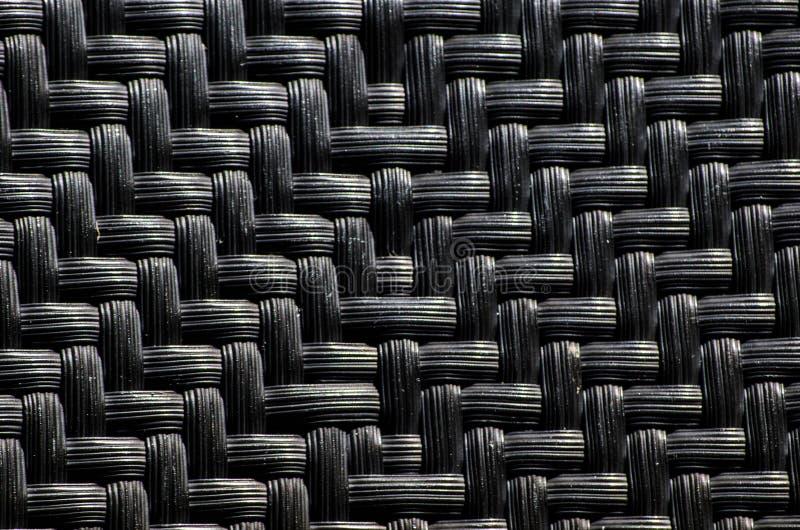 Czarny plastikowy pleciony wzoru proces tkactwo lub szyć pliable materiały zdjęcie stock