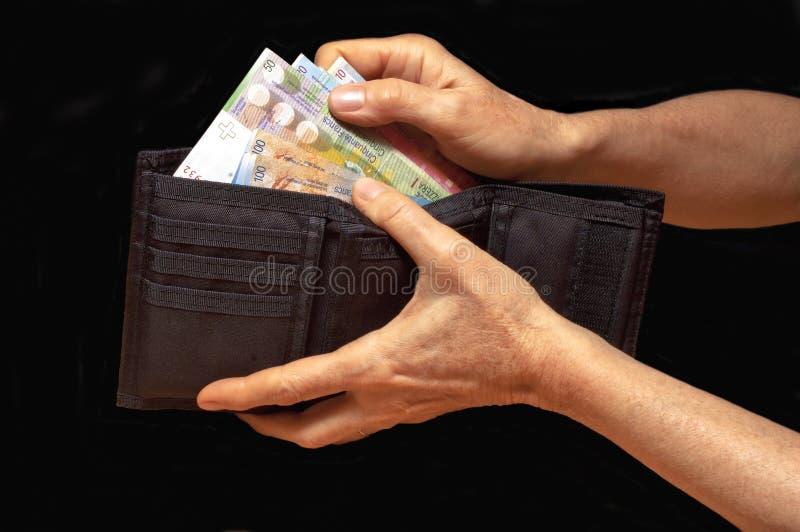 Czarny portfel z pieniądze zdjęcie stock