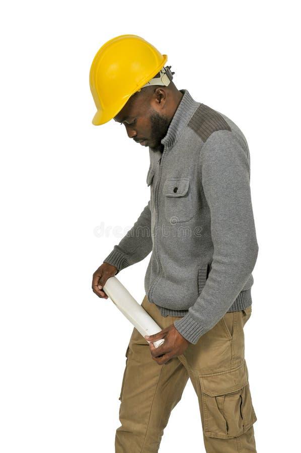 Czarny pracownik budowlany z projektami obraz stock