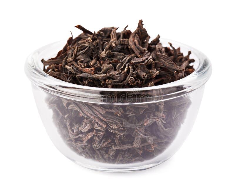 czarny pucharu szklana rozsypiska liść herbata przejrzysta zdjęcia stock