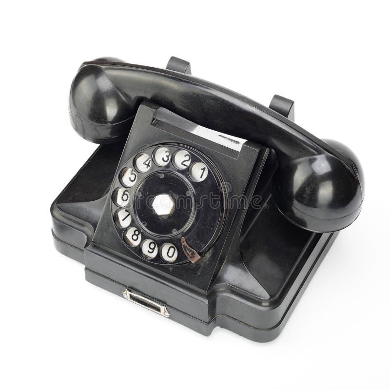 Czarny rocznika telefon na białym tle zdjęcie royalty free