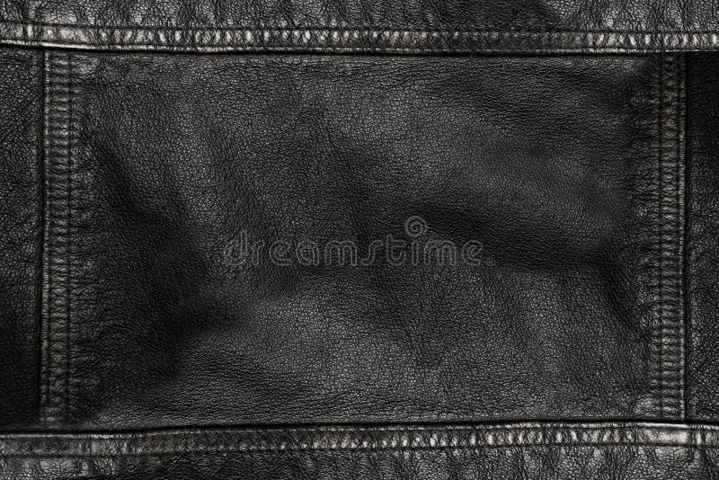 Czarny rzemienny tekstury tło z szwami na wszystkie stronach fotografia stock