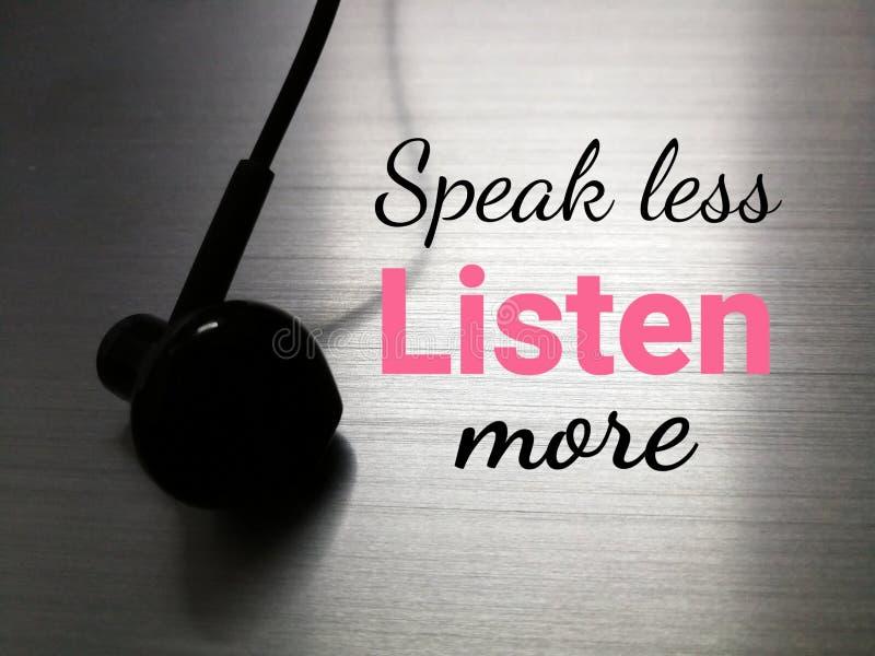 Czarny słuchawka z tekstem mówi mniej słuchać obraz stock