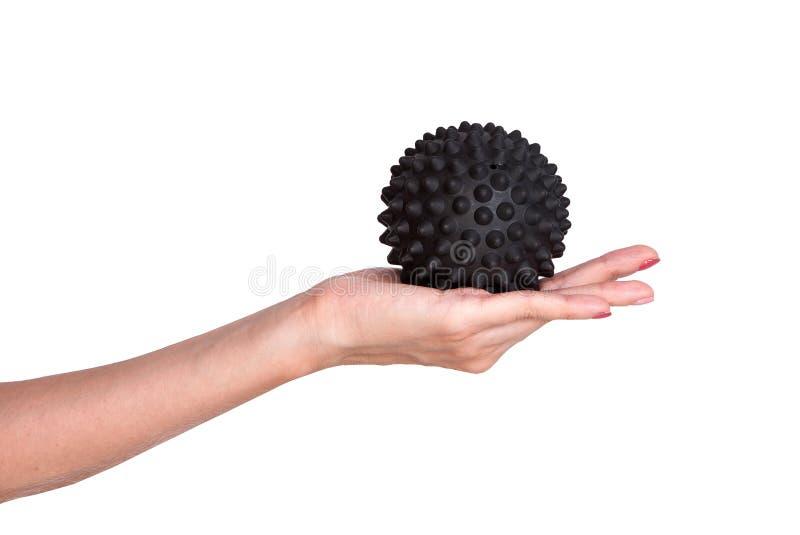 Czarny spiky balowy masaż w żeńskiej ręce zdjęcie royalty free