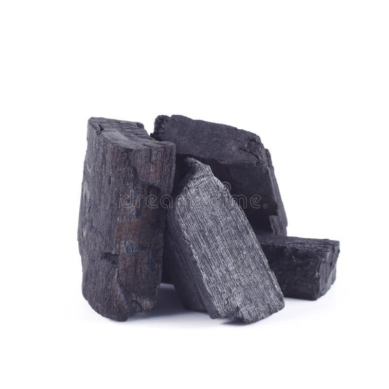 Czarny węgiel drzewny odizolowywający na bielu zdjęcia stock