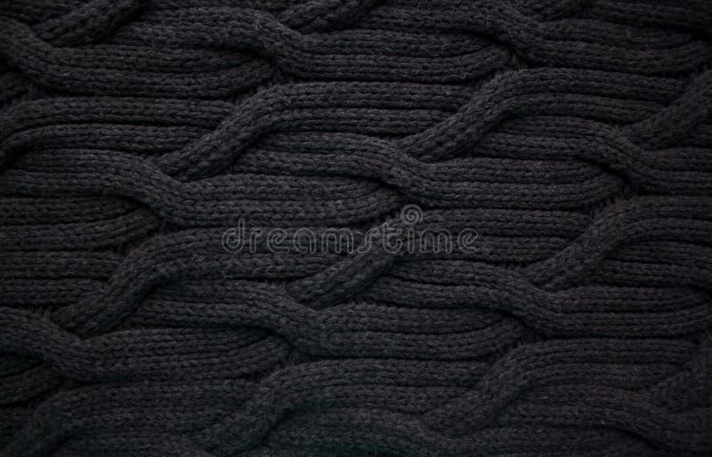 Czarny woolen kablowy dzianina wzór obrazy stock