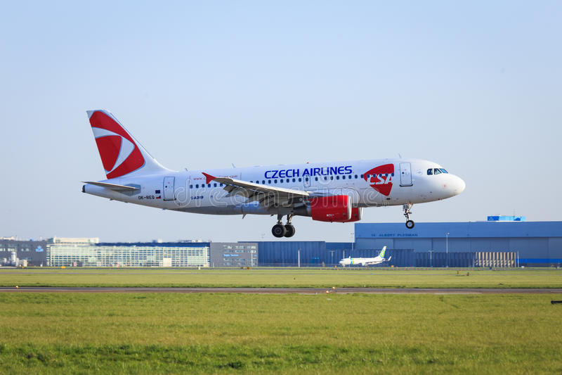 Czech airlines Airbus A319 landing. Side shot of Czech Airlines Airbus A319 landing at Amsterdam Schiphol Airport royalty free stock image