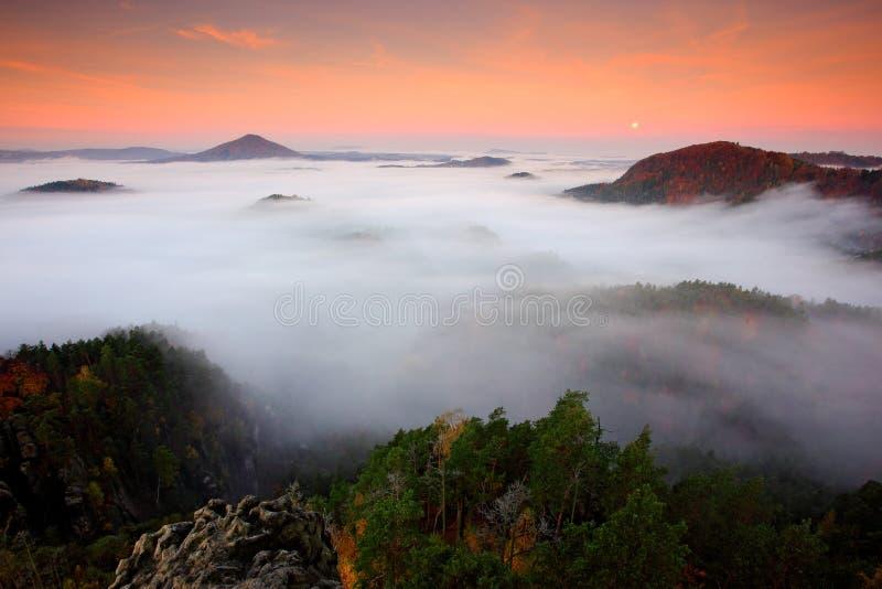 Czech autumn landscape. Hills and villages with foggy morning. Morning fall valley of Bohemian Switzerland park, Ceske Svycarsko,. Wild Europe. Orange sunrise royalty free stock image