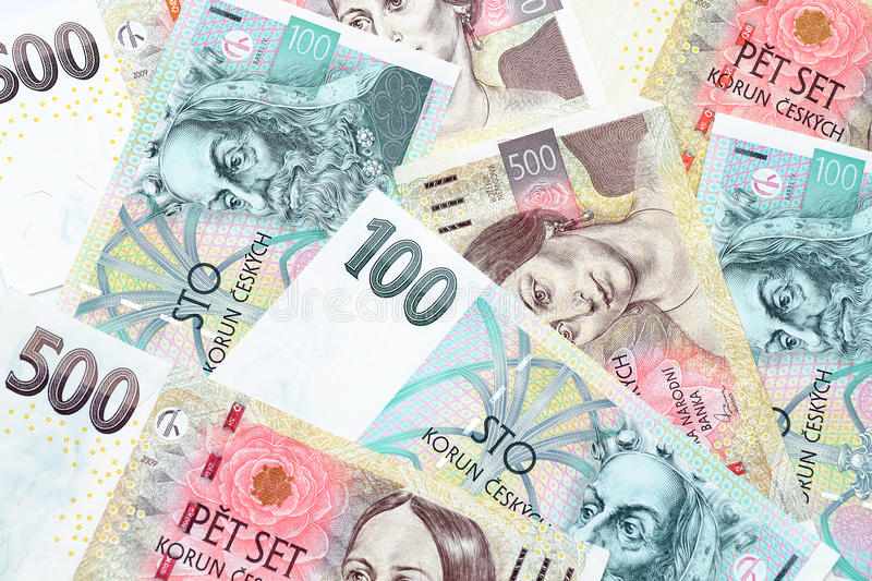 Czech crowns. Different czech crowns banknotes on a plain surface royalty free stock photography