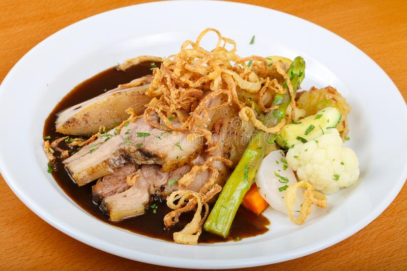 Czech cuisine - roasted pork. With asparagus and vegetables stock photo