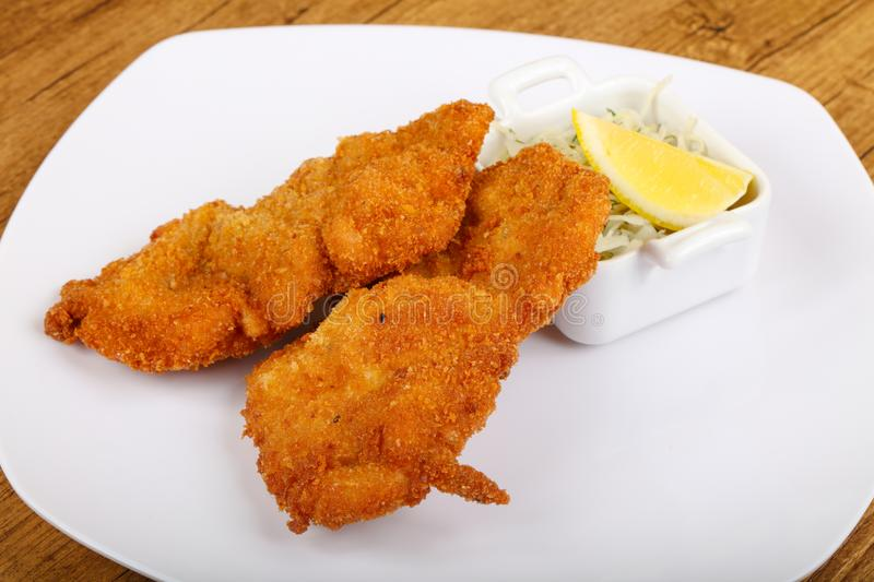 Czech cuisine - schnitzel. With cabbage and lemon stock photography