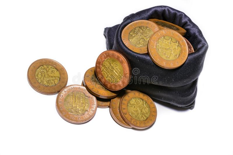 Czech gold coins in a black bag on a white background royalty free stock image