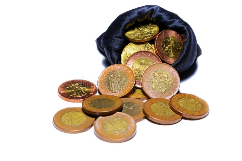 Czech gold coins in a black bag on a white background stock image