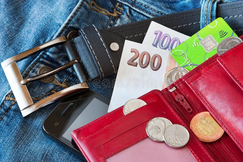 Czech personal belongings from the trousers pocket. Purse, paper money, sun glasses and mobile phone royalty free stock images