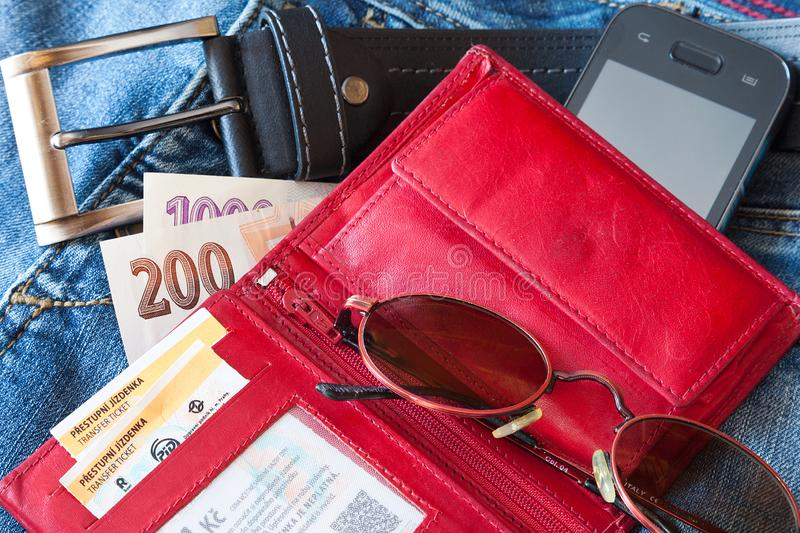 Czech personal belongings from the trousers pocket. Purse, paper money, sun glasses and mobile phone stock photo