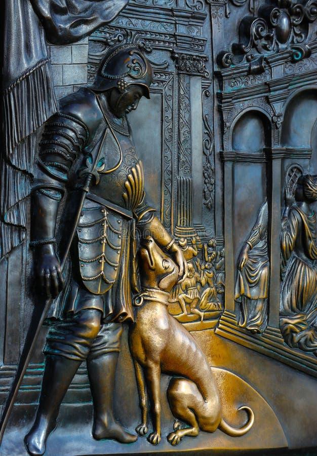 Czech, Prague, Statue of John of Nepomuk, lucky dog part superstition, the Charles bridge. Prague, medieval art, statue of Saint stock image