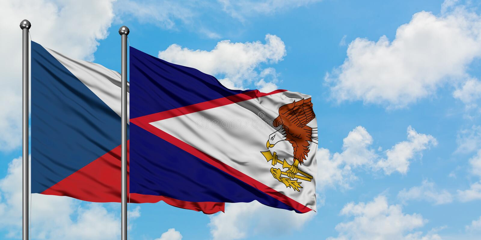 Czech Republic and American Samoa flag waving in the wind against white cloudy blue sky together. Diplomacy concept, international. Relations, consul, diplomat royalty free stock photography