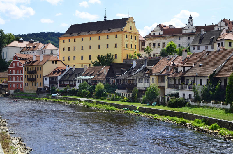 Czech Republic, Bohemia. Cesky Krumlov, Czech Republic, Moldau river, homes, buildings and tourists on sightseeing in the Unesco World Heritage site in Bohemia stock photo