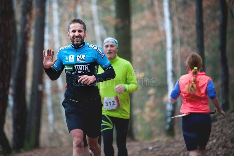 Hannah Pilsen Trail Krkavec. Runner Waving into the Camera. Czech Republic, Pilsen, November 2018: Hannah Pilsen Trail Krkavec. Runner Waving into the Camera stock images