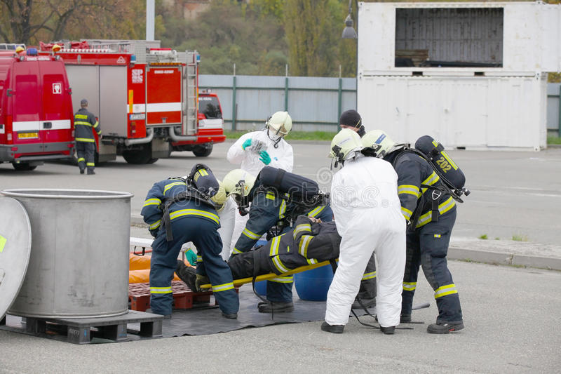 CZECH REPUBLIC, PLZEN, 4 JUNY, 2014: Fire departments and emergency team in protective suits. Rescue stock photo