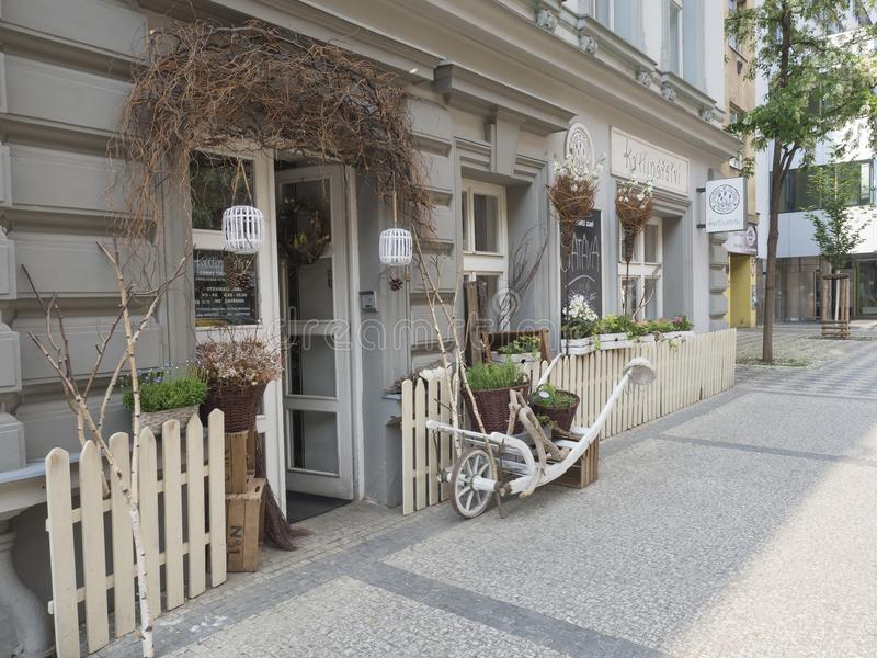 Czech Republic, Prague, Karlin, May 11, 2018: florist shop window, entrance decorated with dry birch tree branches flower pots na stock photos