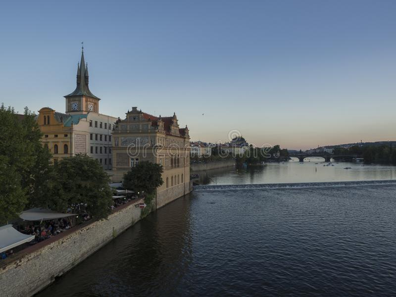 Czech Republic, Prague , September 8, 2018: View from the Charles Bridge on Novotneho lavka with Bedrich Smetana Museum. During sunset hour royalty free stock images