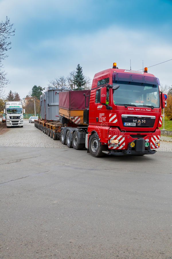 CZECH REPUBLIC, PRESTICE, 11 NOVEMBER, 2014:Transport of heavy, oversized loads and construction machinery. Blue sky stock image