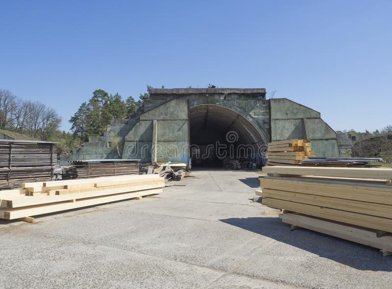 Czech Republic, Ralsko, April 26, 2019: former Soviet army concrete hangar shelter, serving as lumber mill on airport at stock image