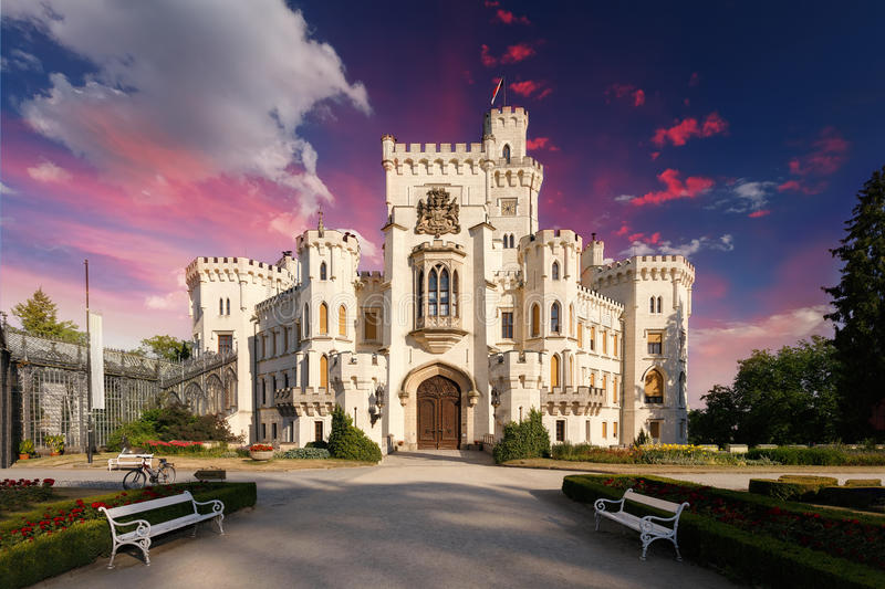 Czech Republic - white castle Hluboka nad Vltavou. Beautiful white renaissance castle castle Hluboka nad Vltavou in the Czech Republic with abstract clouds royalty free stock photo